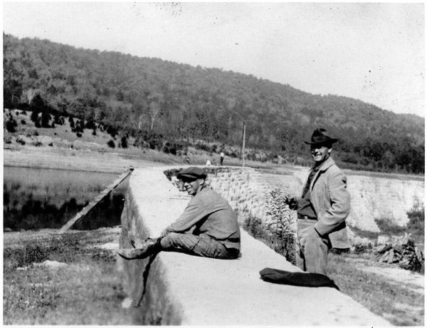 Former foreman of Kingsport Water Department, Parks Grills (on right) and an unidentified man at Bays Mountain Dam, undated.